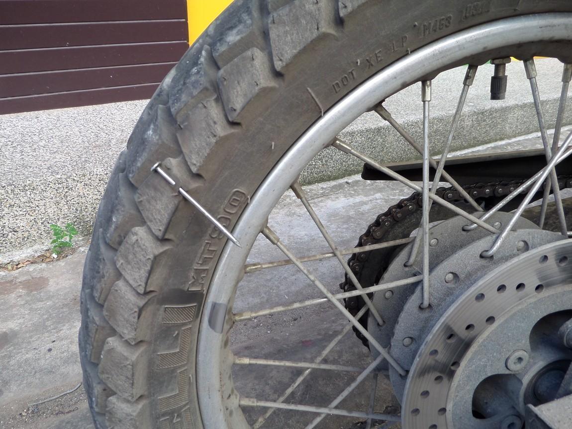 Chumphon-Thiland-nail-in-tire.