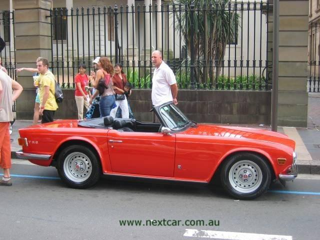 e.i.2006.mfs.triumph.TR6.red.r.00.70.jpg /1973 book/General Discussion / News / Information/  - Image by:
